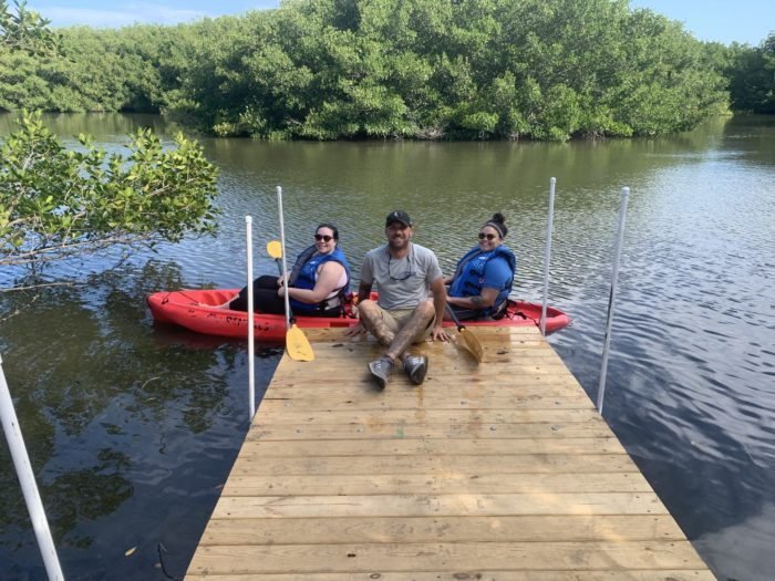 Chad with guests renting a tandem kayak