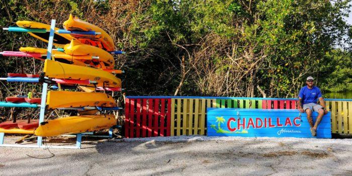 Chadillac Adventures sign and kayaks